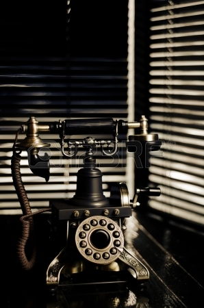 25370409-vintage-telephone--film-noir-scene-with-retro-phone-and-blinds